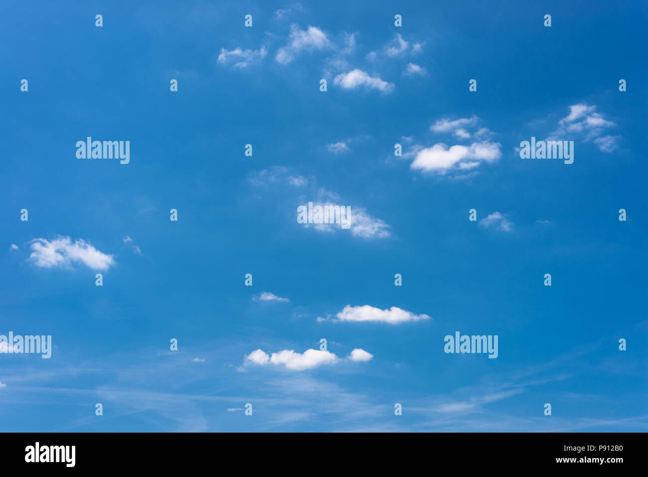 Beautiful blue sky with clouds on a hot summer day. - Stock Image