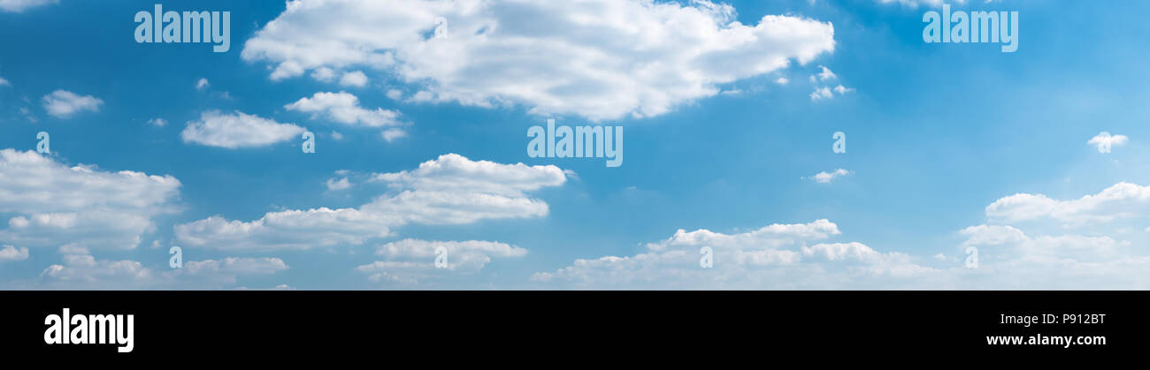 Panorama of beautiful blue sky with clouds on a hot summer day. High resolution - Stock Image