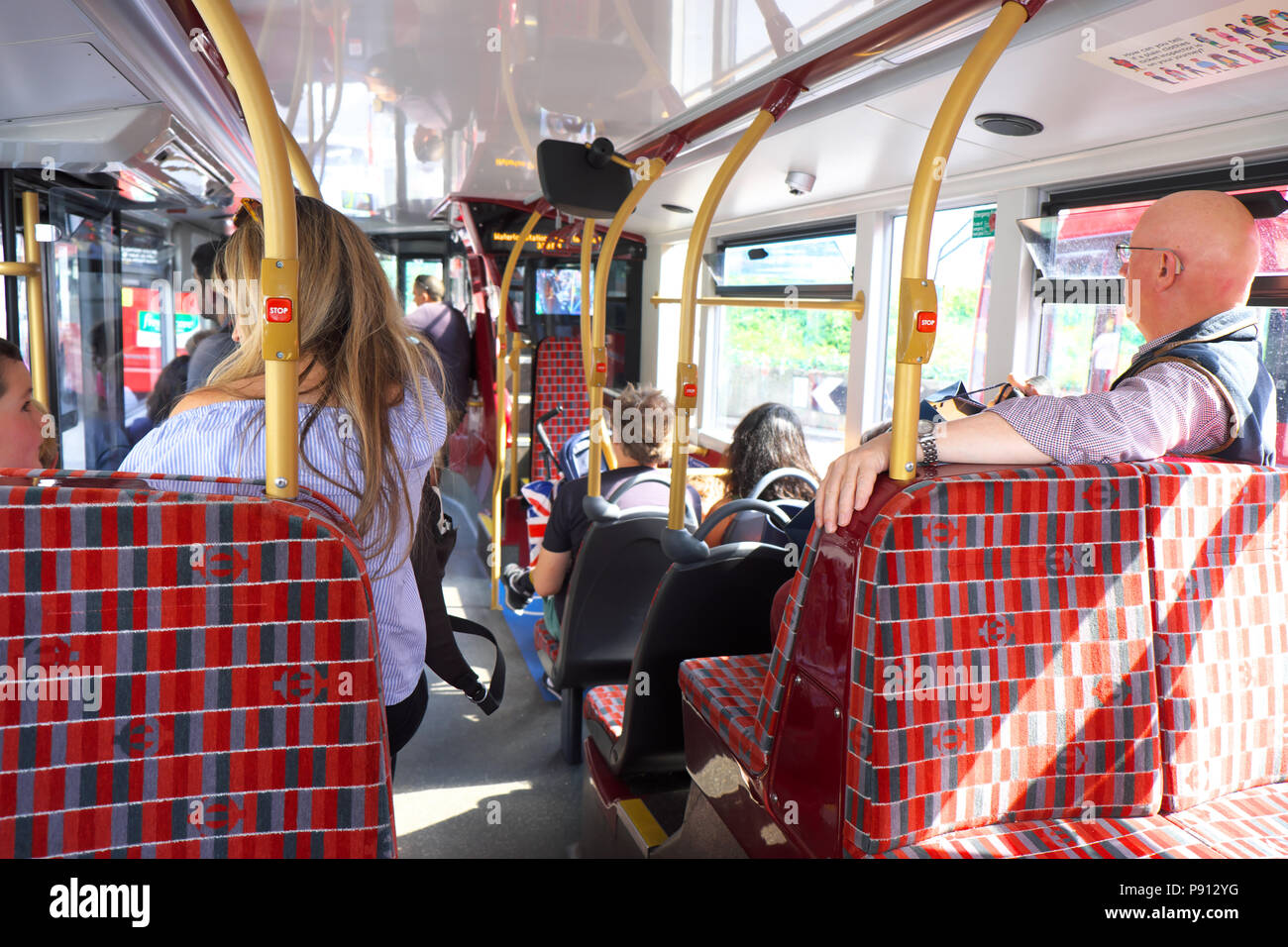 London UK passengers inside and onboard a TFL bus - Stock Image