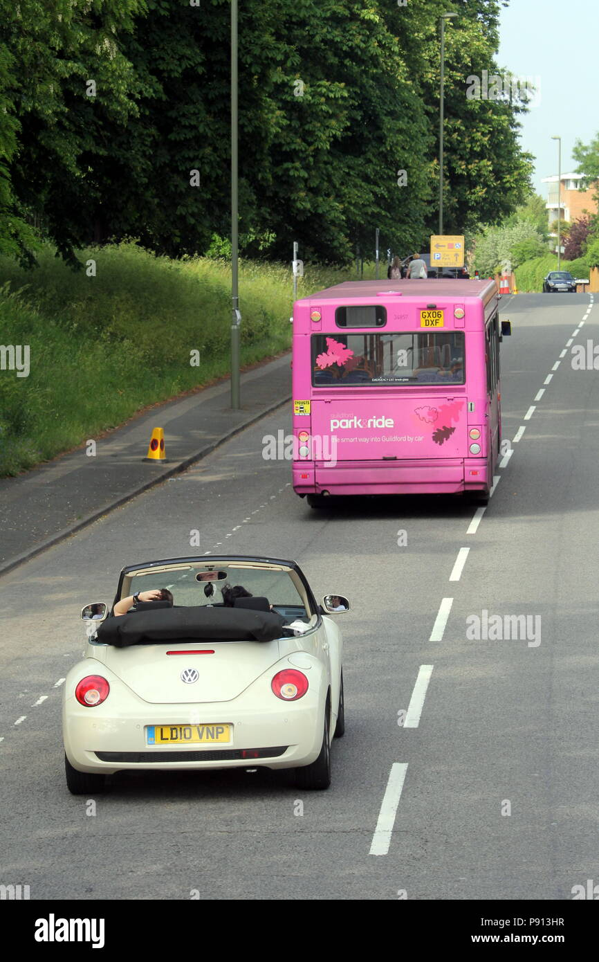 Guildford England May 28 2018 Pink Park And Ride Bus Being Followed Down The Road By A Vw Beetle Convertible Stock Photo Alamy