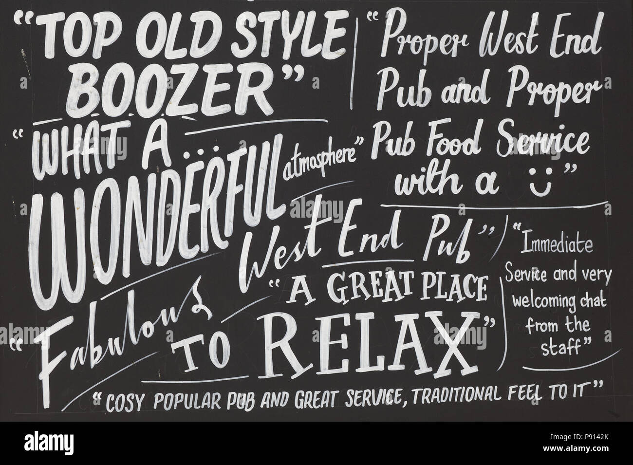 traditional British west end pub, blackboard sign Stock Photo