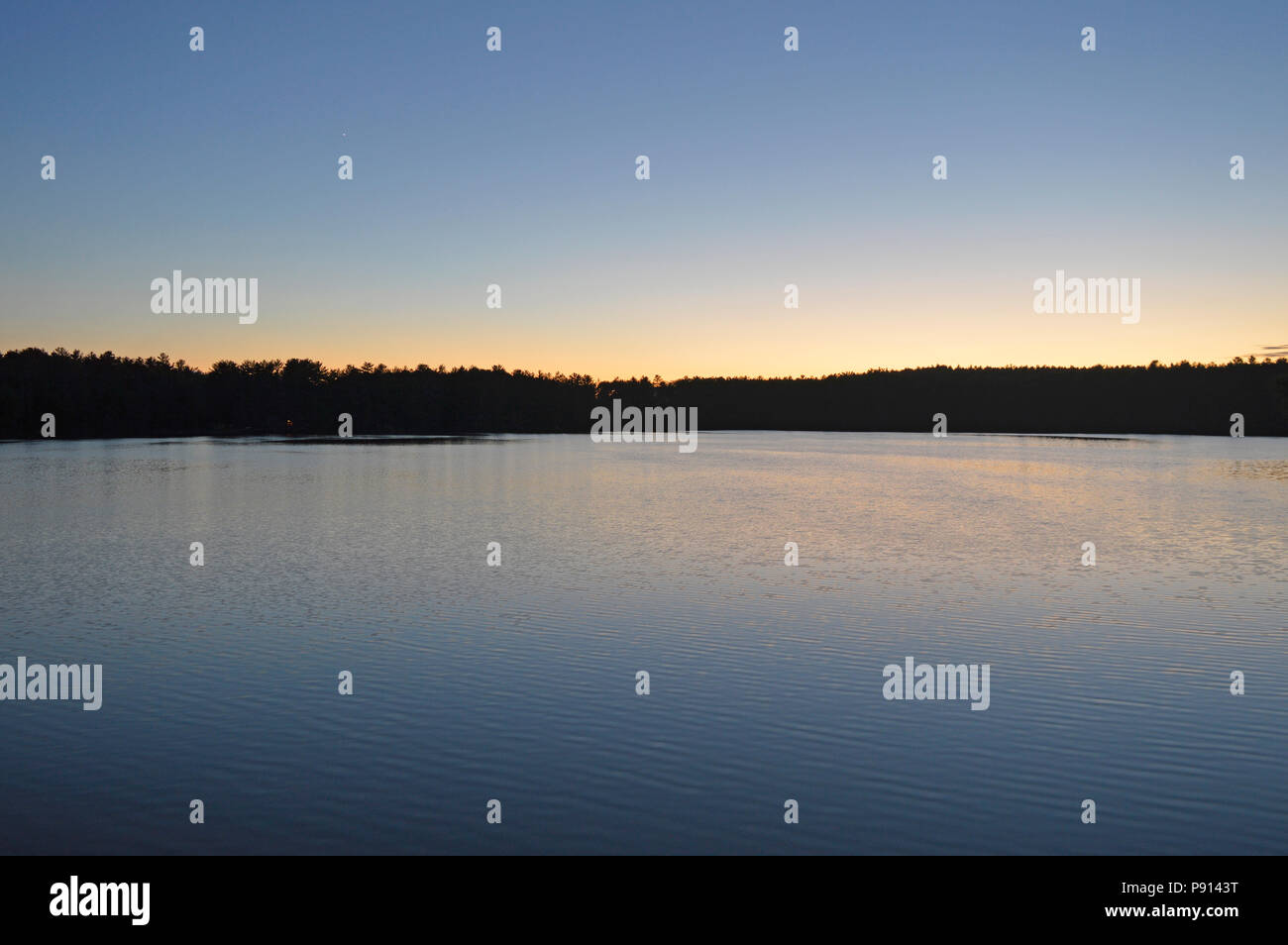 A cloudless sunset over Western Quebec, near Ladysmith, Quebec, Canada on a mid-summer evening. - Stock Image