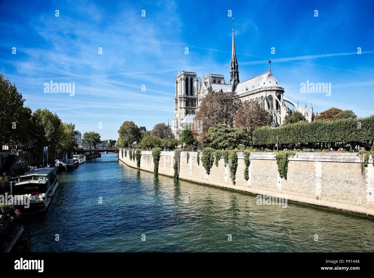 Notre Dame sits above the River Seine in central Paris, France. - Stock Image