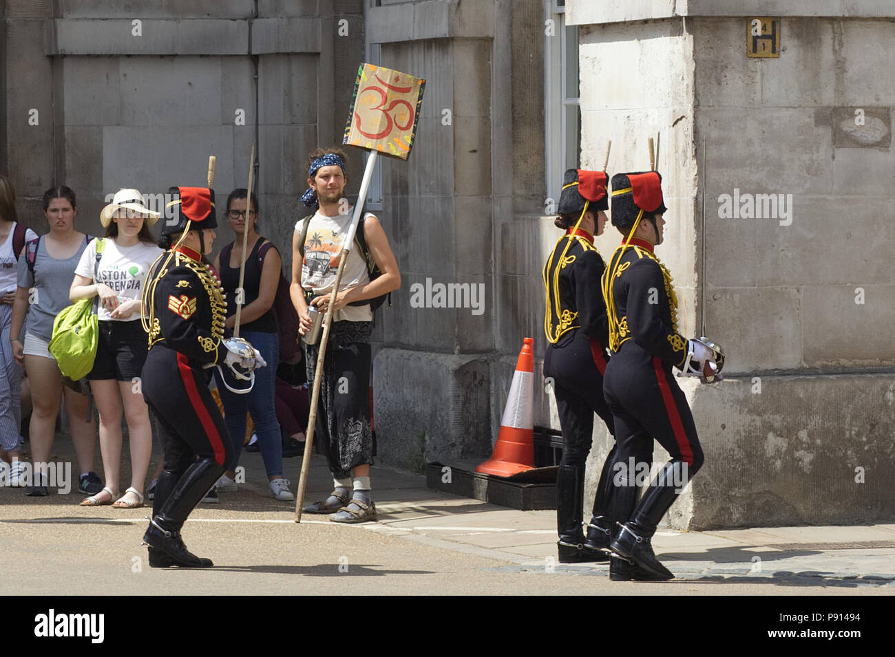 King S Troop Royal Horse Artillery Women Walking To Barracks With Swords Drawn And A Man Holding Sacred Aum Symbol For Peace Stock Photo Alamy