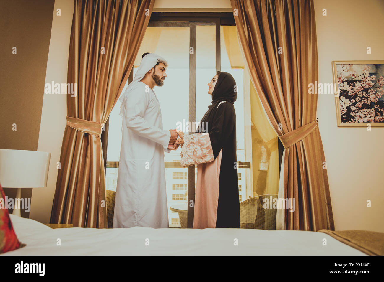 Happy arabic couple of lovers at home stock image