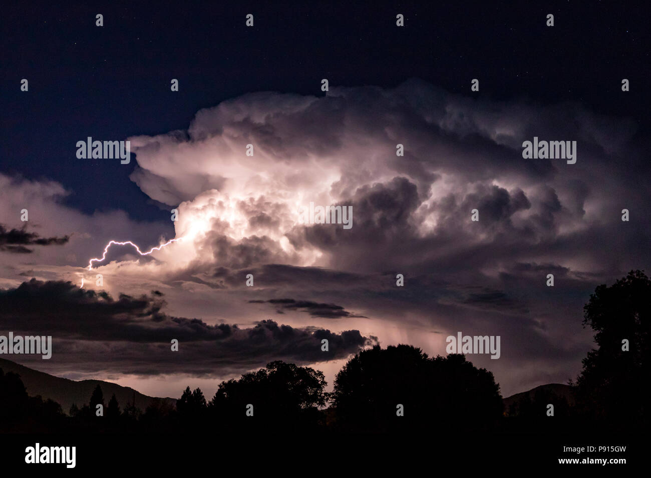 Dramatic lightning storm illuminates nighttime sky; Salida; Colorado; USA Stock Photo
