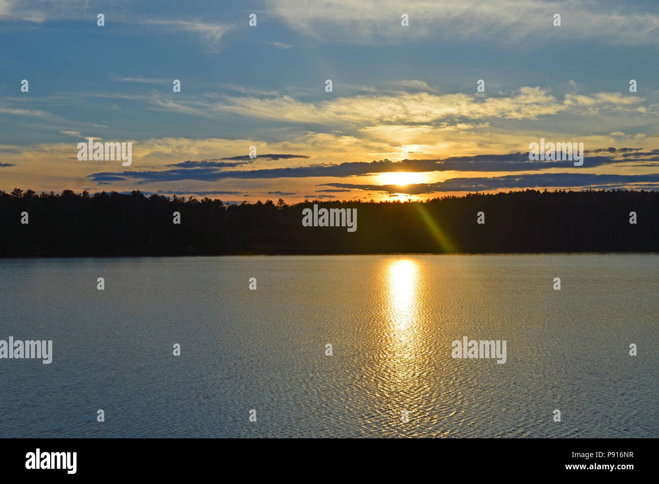 As the sun sets on Reukwald lake in LadySmith, Quebec, Canada on a mid-summers evening - Stock Image