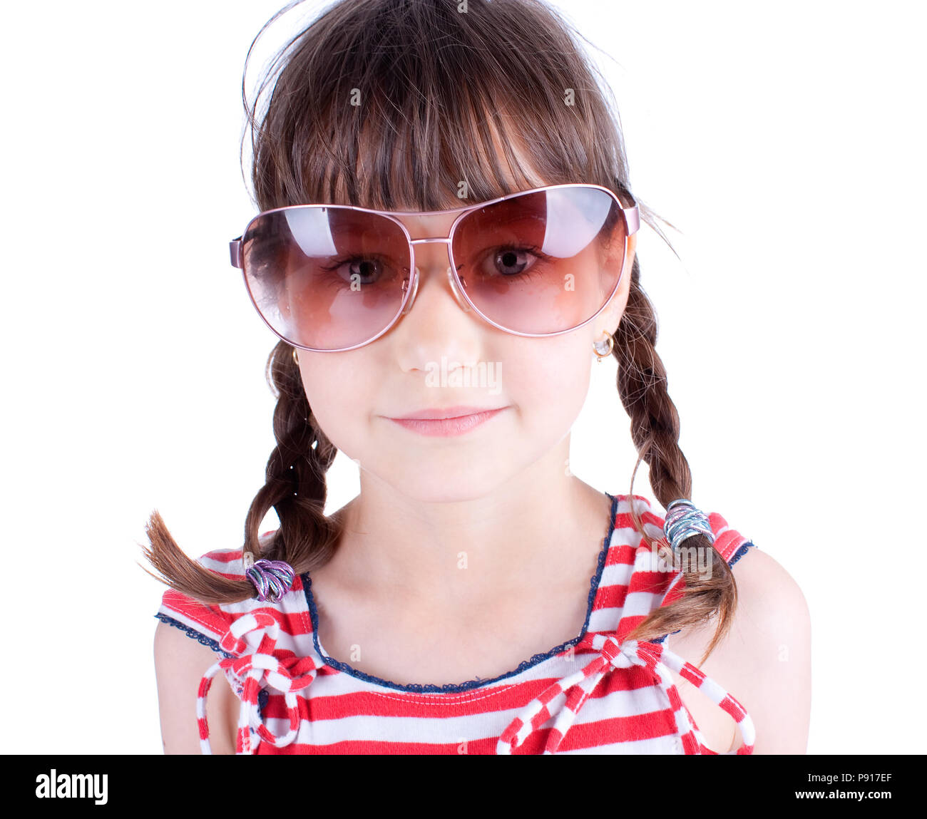 f40d5521a611 Cute little girl with sunglasses posing