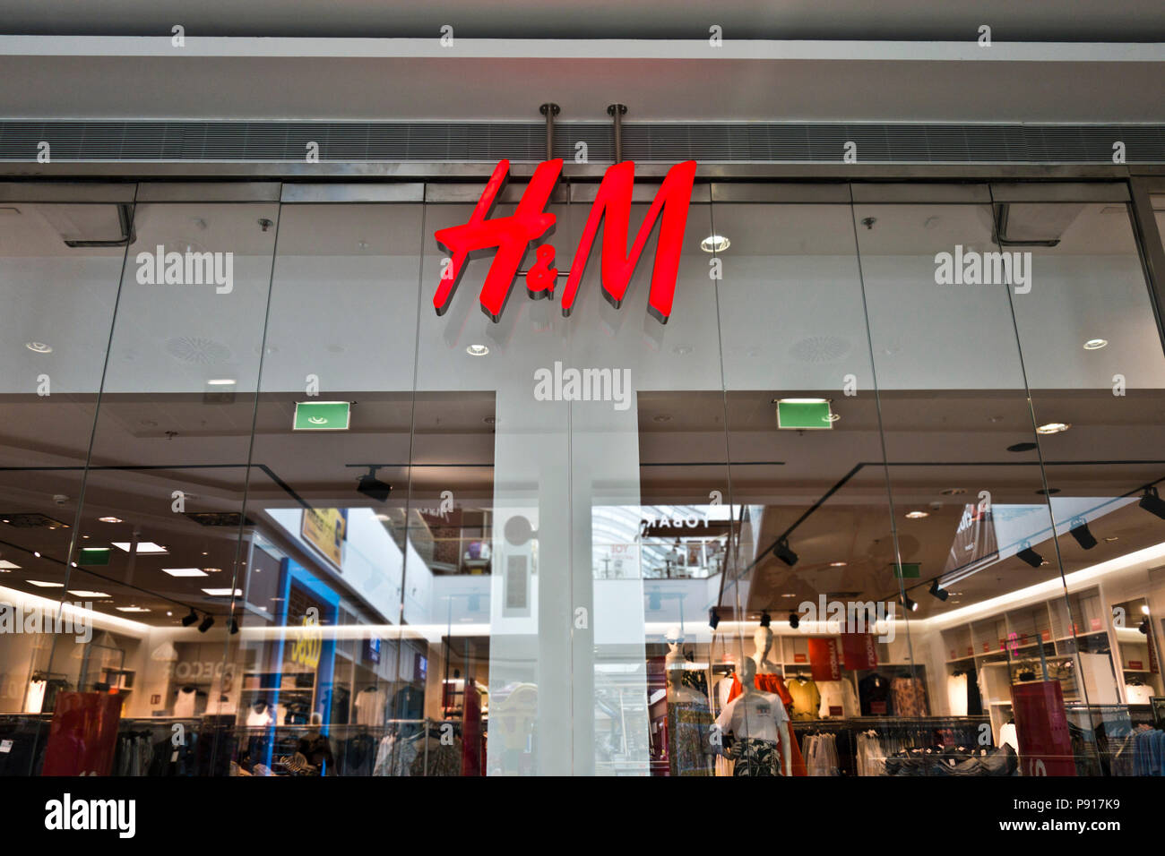 H&M store entrance with logo - Stock Image