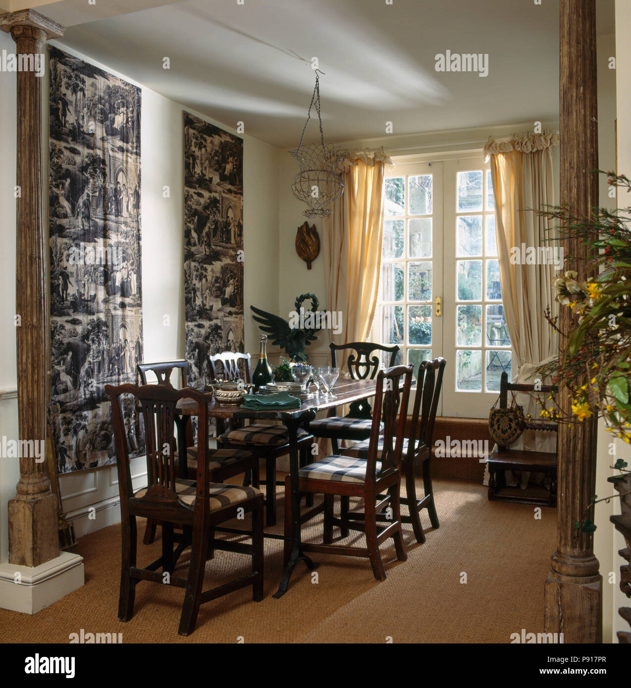 Superieur Heavy Wood Chairs At Table In Dining Room With Toile De Jouy Wall Hangings  And Sisal Carpet