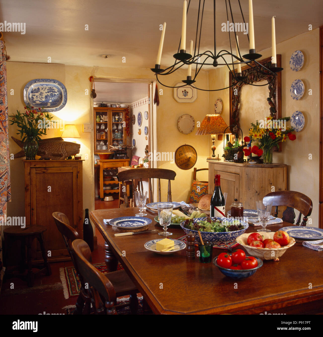candle chandelier above table set for lunch in cottage dining room rh alamy com
