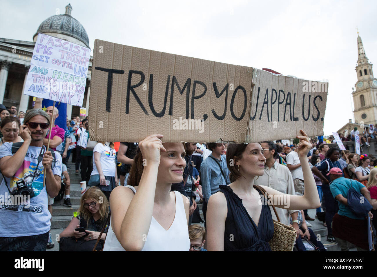 London, UK. 13th July, 2018. Over 100,000 people attend the Together Against Trump national demonstration rally in Trafalgar Square in protest against the visit to the UK of US President Donald Trump. Protests also took place at all venues in the UK visited by the US President and a large policing operation was in place at all protest sites. Credit: Mark Kerrison/Alamy Live News - Stock Image