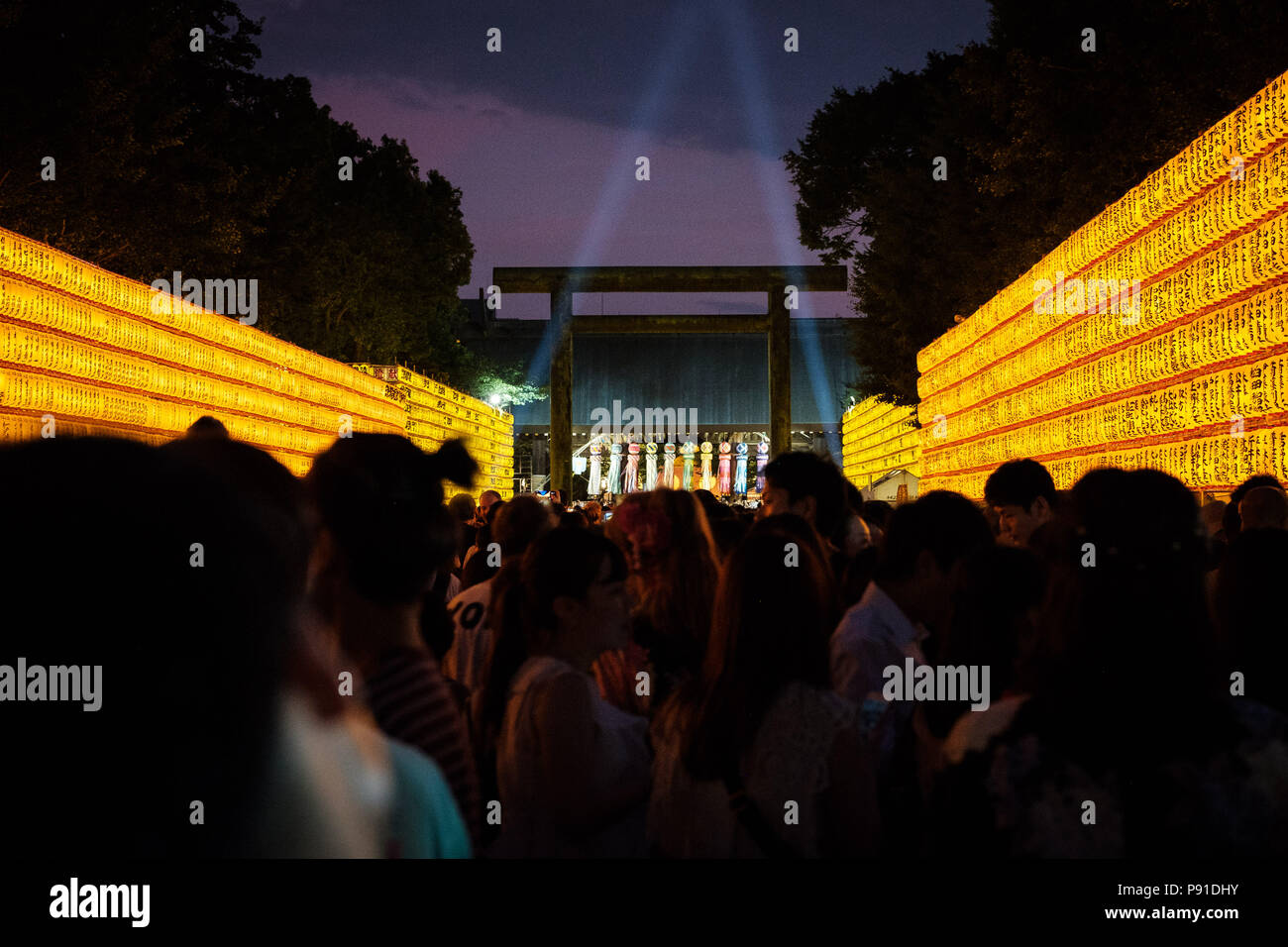 Tokyo, Japan, 13 July 2018. Visitors walk past lit paper lanterns during the Mitama Matsuri summer festival at Yasukuni Shrine on July 13, 2018 in Tokyo, Japan. The four-day traditional festival takes place during Tokyo's Bon period in July attracting about 300,000 visitors, according to the shrine. July 13, 2018 Credit: Nicolas Datiche/AFLO/Alamy Live News - Stock Image