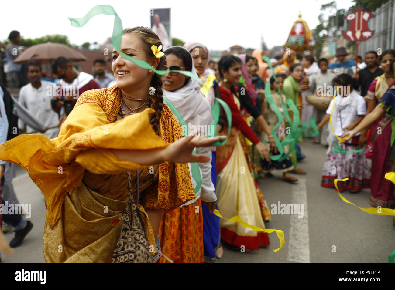 Kathmandu, Nepal. 14th July, 2018. Devotees dressed in traditional attire dance and sing during a procession held to celebrate Jagannath Rath Yatra, a chariot festival in Kathmandu, Nepal on Saturday, July 14, 2018. This procession is a replica of the famous Jagannath Rath Yatra held annually in Jagannath Puri, Odisha since 10th-11th century. Ratha Yatra is a festival that involves moving deities Jagannath, Balabhadra, Subhadra and Sudarshana on a chariot. Credit: Skanda Gautam/ZUMA Wire/Alamy Live News Stock Photo