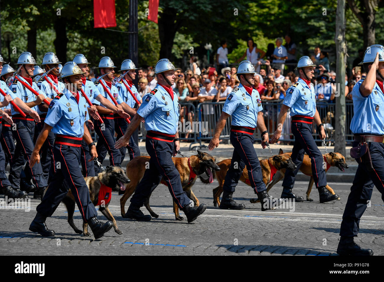 Paris, France. 14th July, 2018. Firefighters march during the annual Bastille Day military parade on the Champs-Elysees Avenue in Paris, France, on July 14, 2018. Credit: Chen Yichen/Xinhua/Alamy Live News Stock Photo