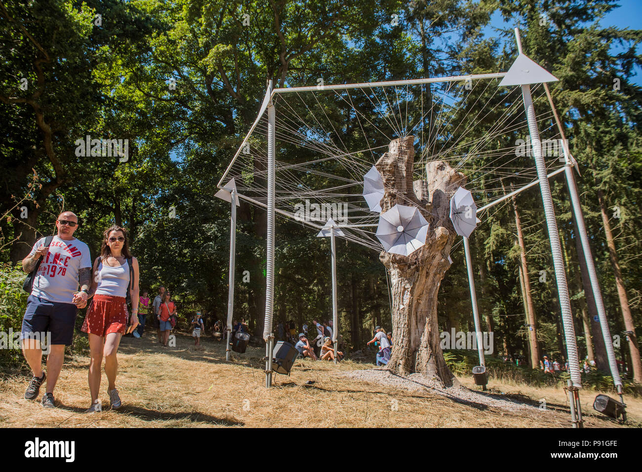 Suffolk, UK, 14 July 2018. An umbrella sculpture in the Faraway Forest - The 2018 Latitude Festival, Henham Park. Suffolk 14 July 2018 Credit: Guy Bell/Alamy Live News - Stock Image