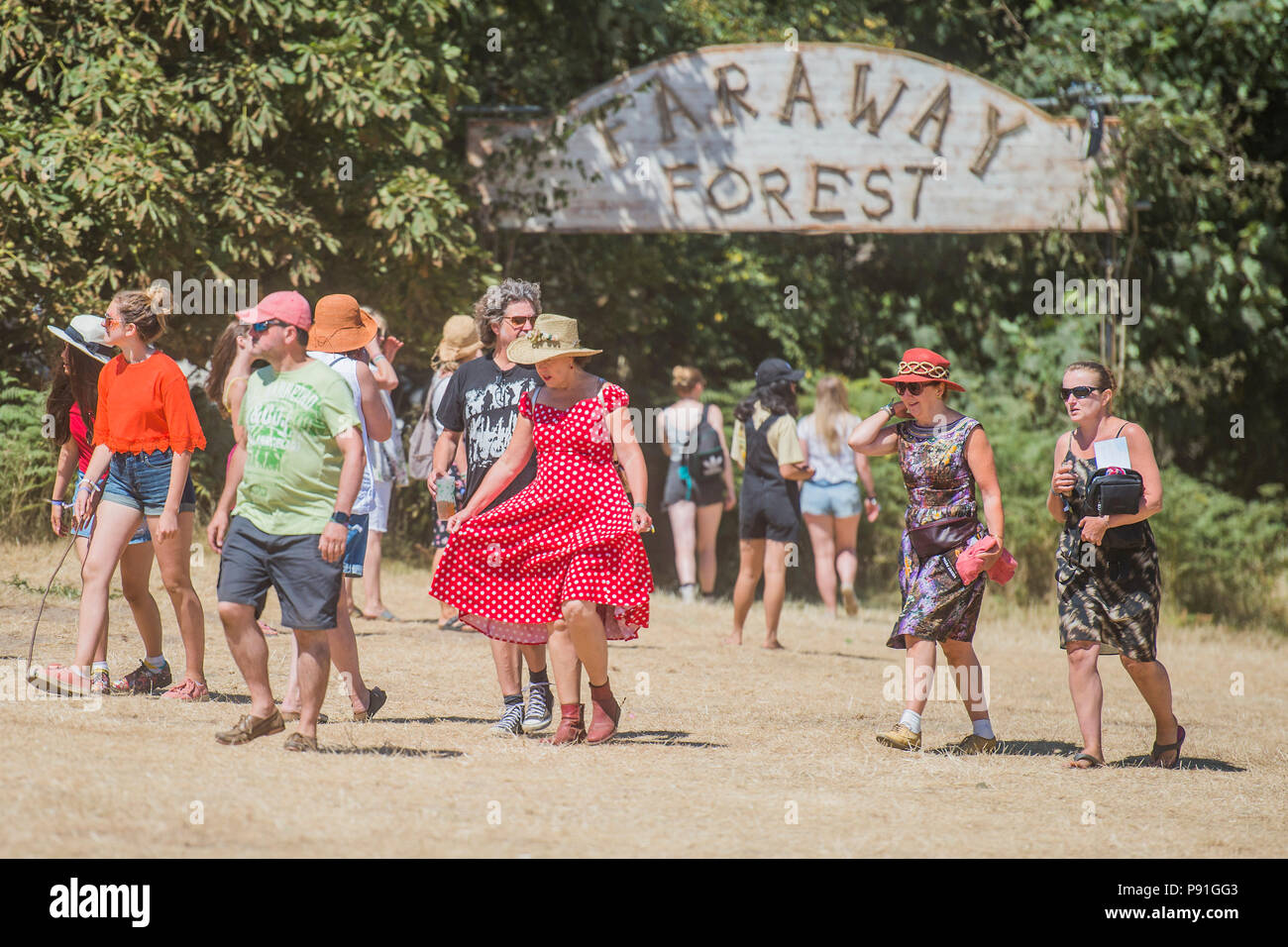Suffolk, UK, 14 July 2018. People leaving the Faraway Forest - The 2018 Latitude Festival, Henham Park. Suffolk 14 July 2018 Credit: Guy Bell/Alamy Live News - Stock Image