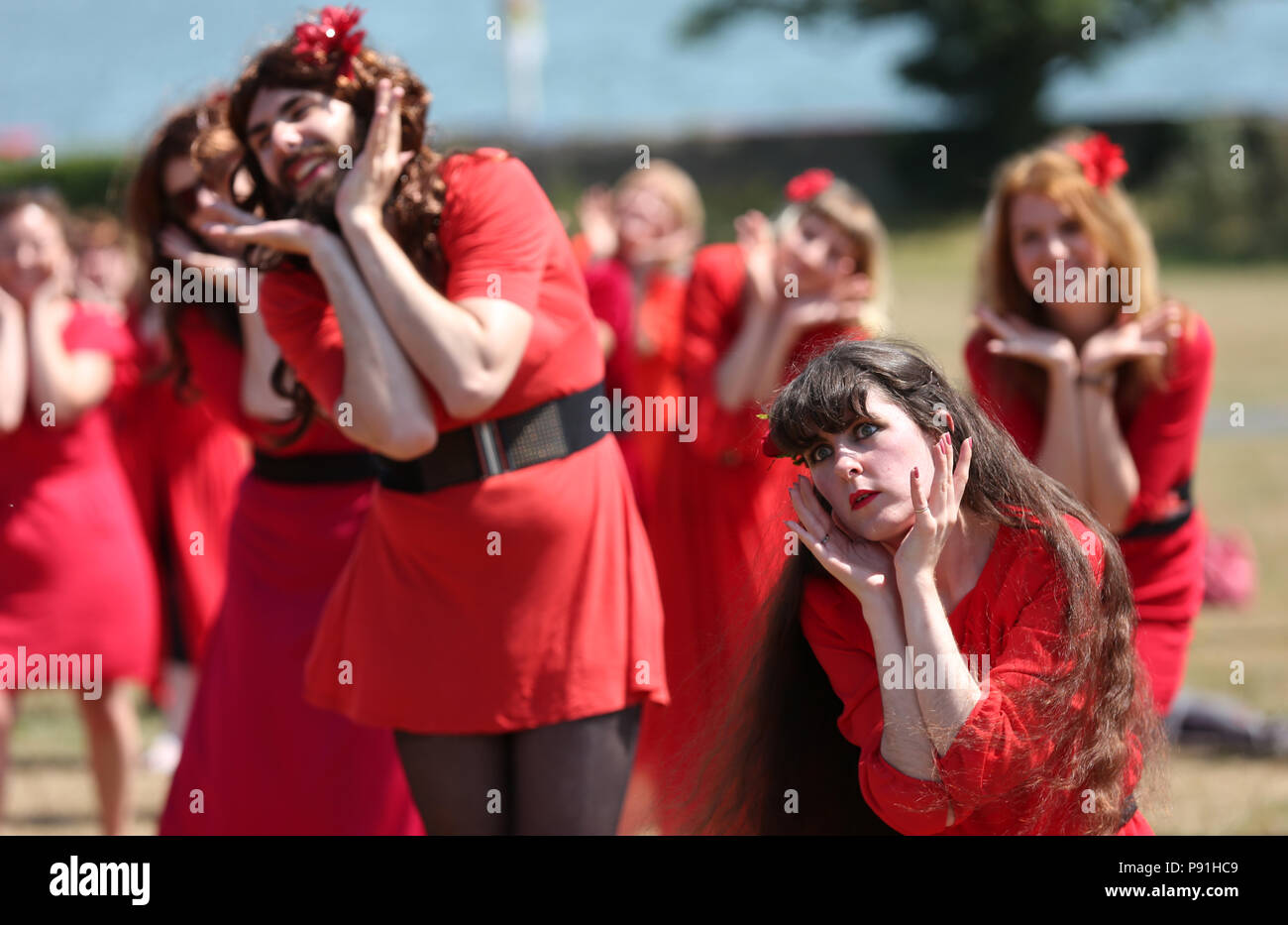 Dublin, Ireland. 14th July 2018. Participants in this year's Wuthering Heights Day rehearse their dance to Kate Bush's iconic song and video of 'Wuthering Heights' at St Anne's Park in Dublin, Ireland.  Credit : Laura Hutton/Alamy Live News. Stock Photo