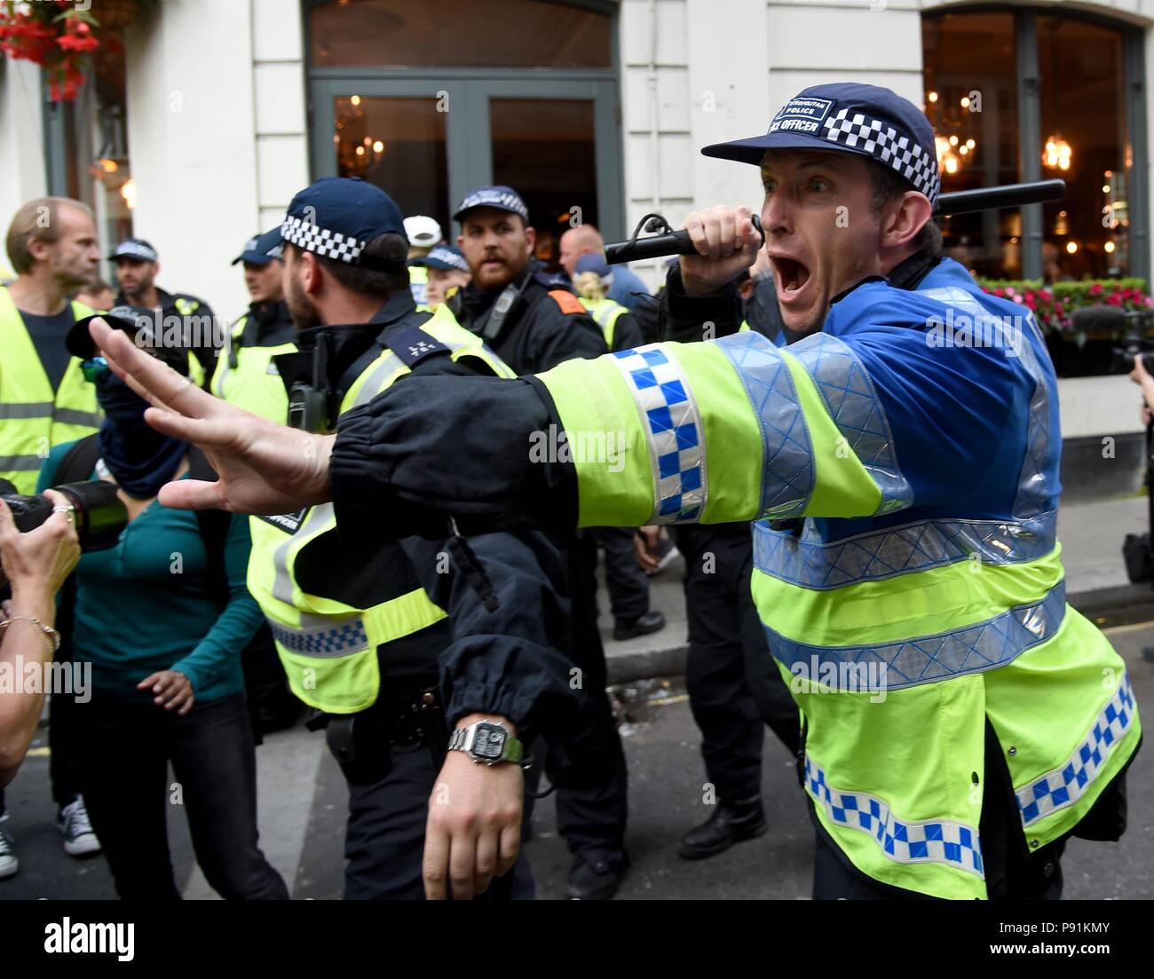 Anti-Fascist and pro Tommy Robinson marchers clash outside Parliament, London, UK Credit: Finnbarr Webster/Alamy Live News - Stock Image