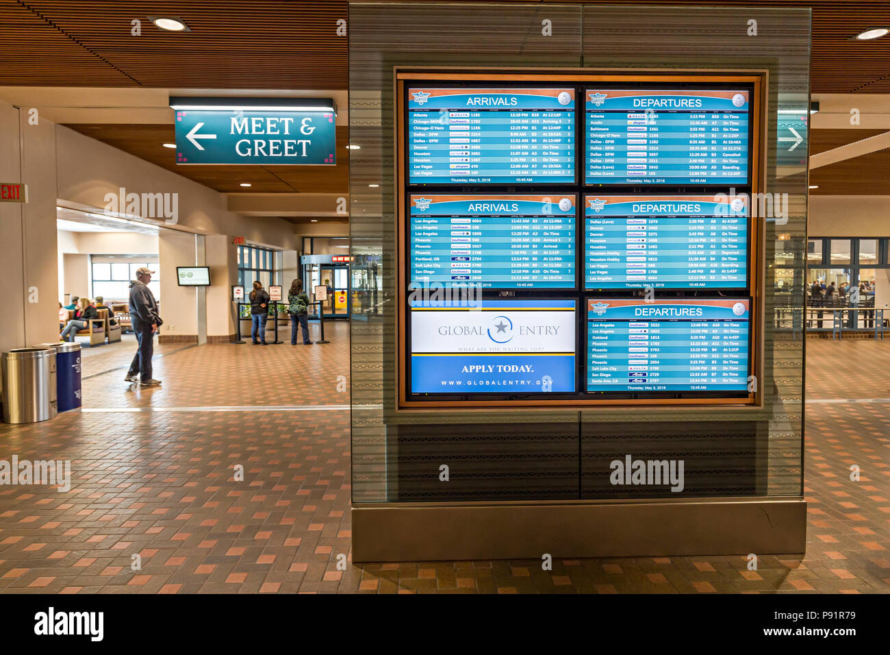 Arrivals and departures board with Meet & Greet sign, airport, Albuquerque, New Mexico, USA - Stock Image