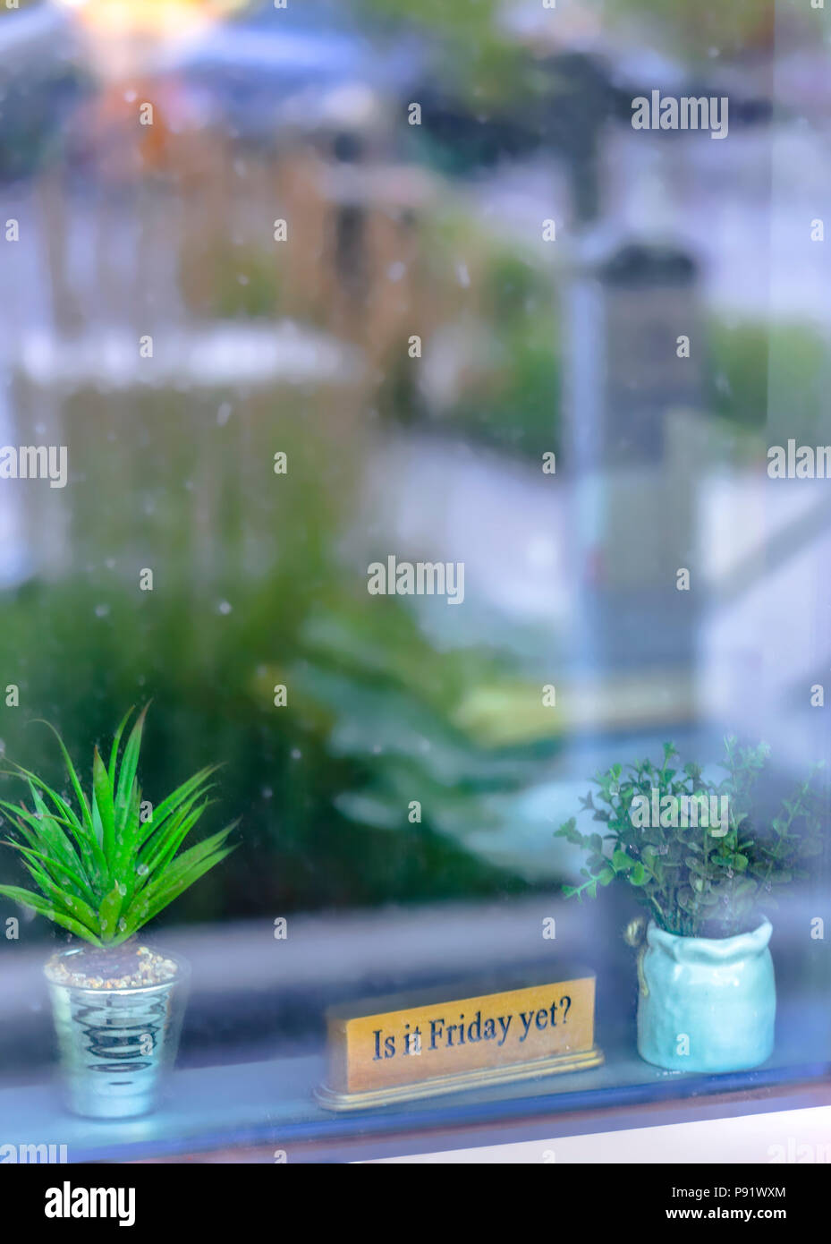Is it friday yet sign in window of exterior - Stock Image