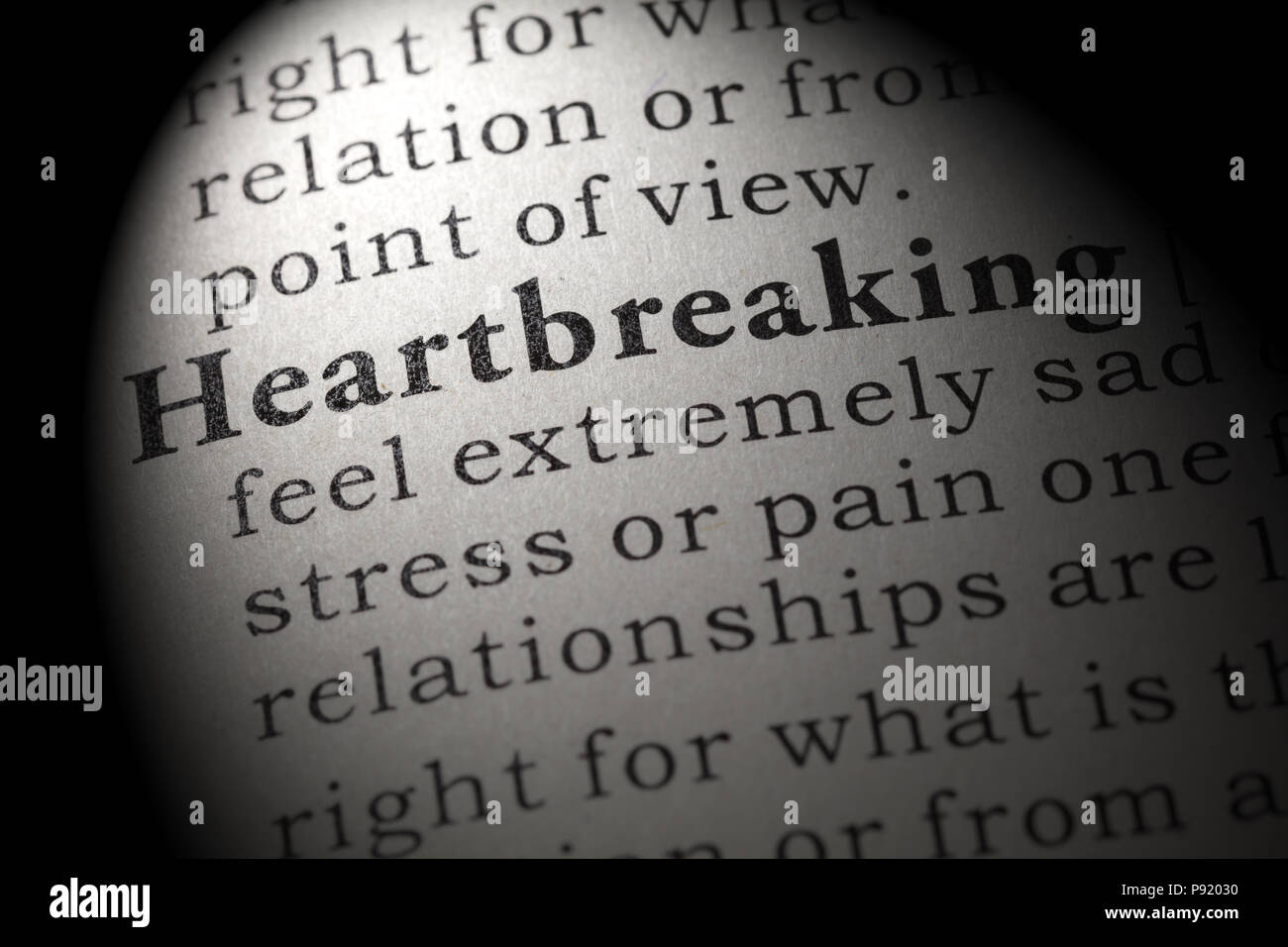 Fake Dictionary, Dictionary definition of the word heartbreaking. including key descriptive words. Stock Photo