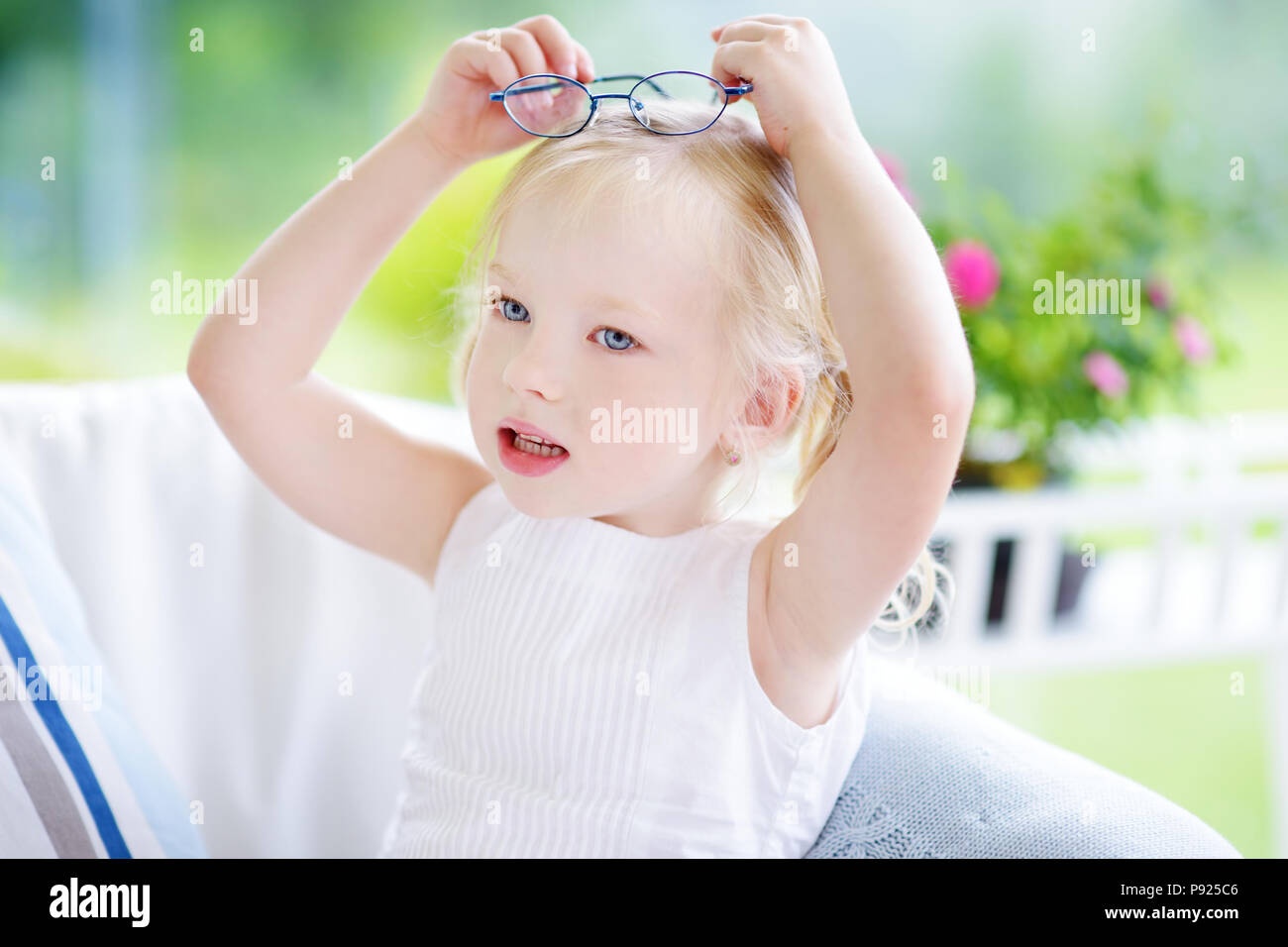 b6b70e05ced Portrait of beautiful little girl wearing glasses at home. Vision ...
