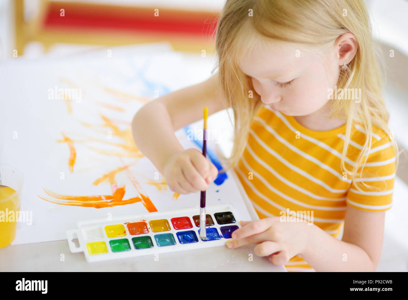 Home office colorful girl Canvas Cute Little Girl Drawing With Colorful Paints At Daycare Creative Kid Painting At School Girl Doing Homework At Home Alamy Cute Little Girl Drawing With Colorful Paints At Daycare Creative
