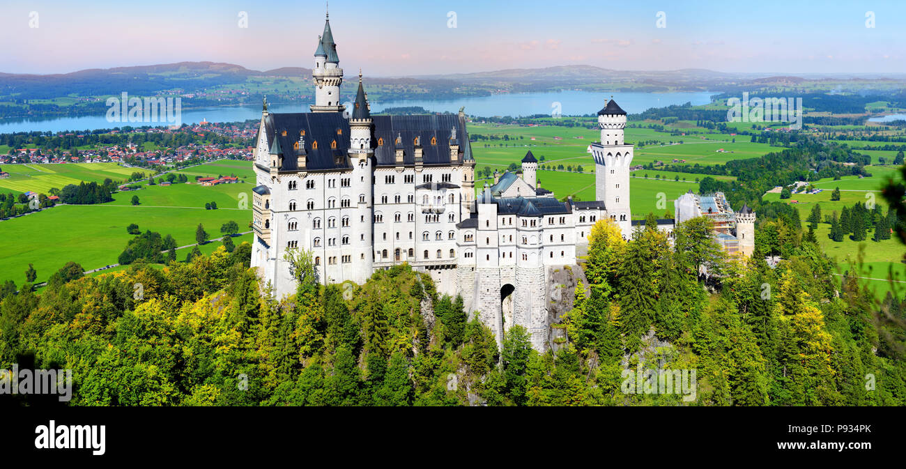 Famous Neuschwanstein Castle, 19th-century Romanesque Revival palace on a rugged hill above the village of Hohenschwangau near Füssen in southwest Bav - Stock Image