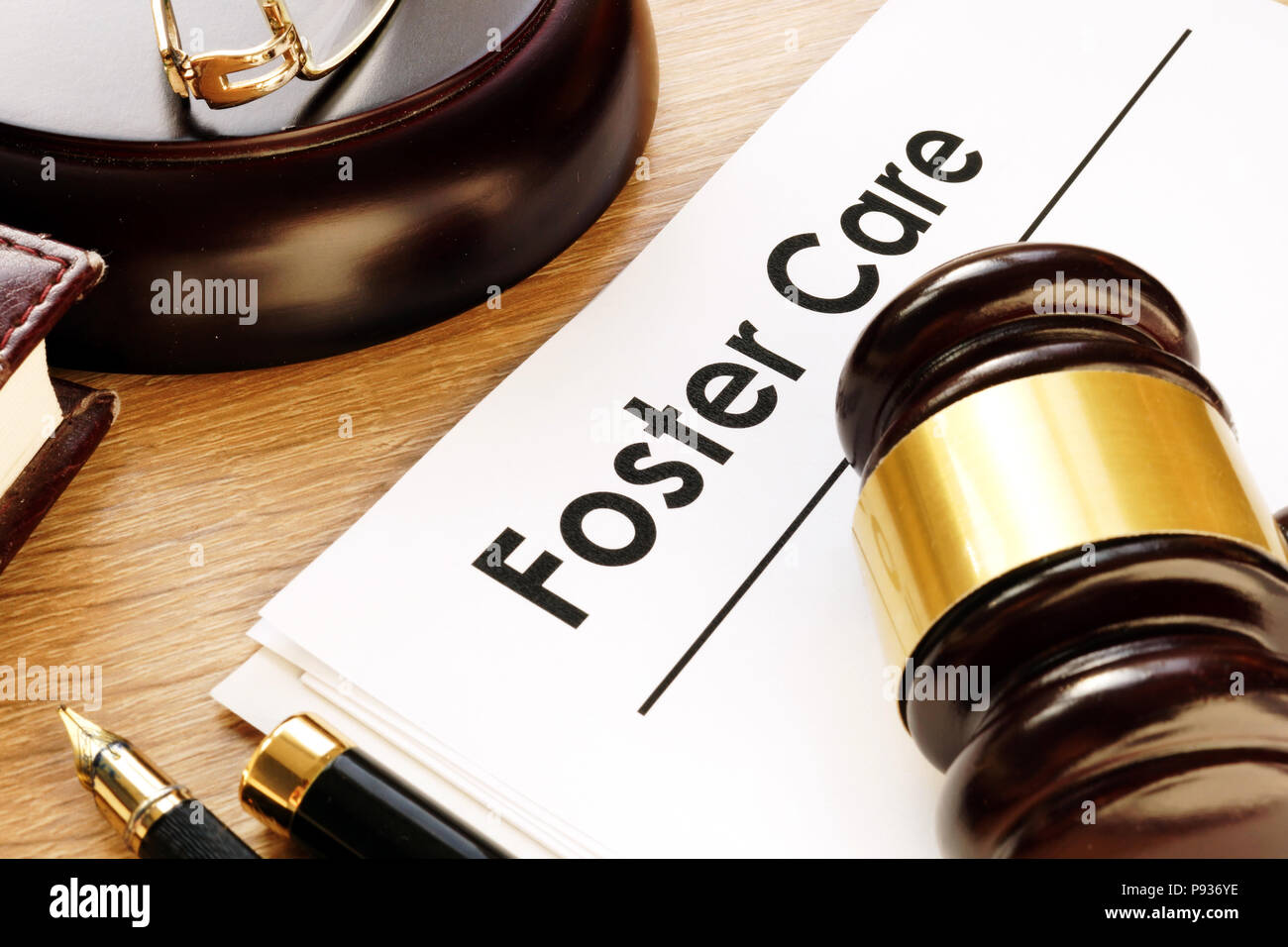 Foster care. Documents and gavel on a desk. - Stock Image