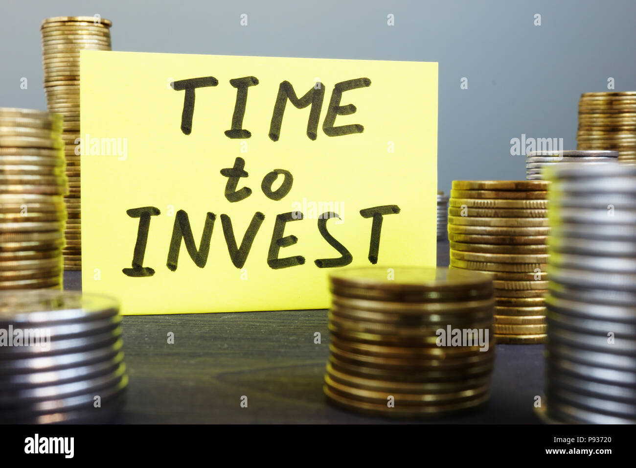 Time to invest. Money and memo stick. - Stock Image