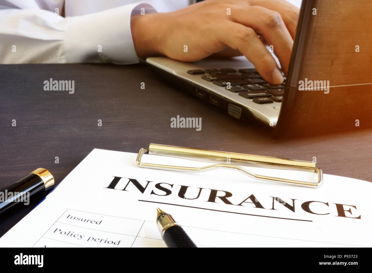 Insurance agreement on an office table. - Stock Image