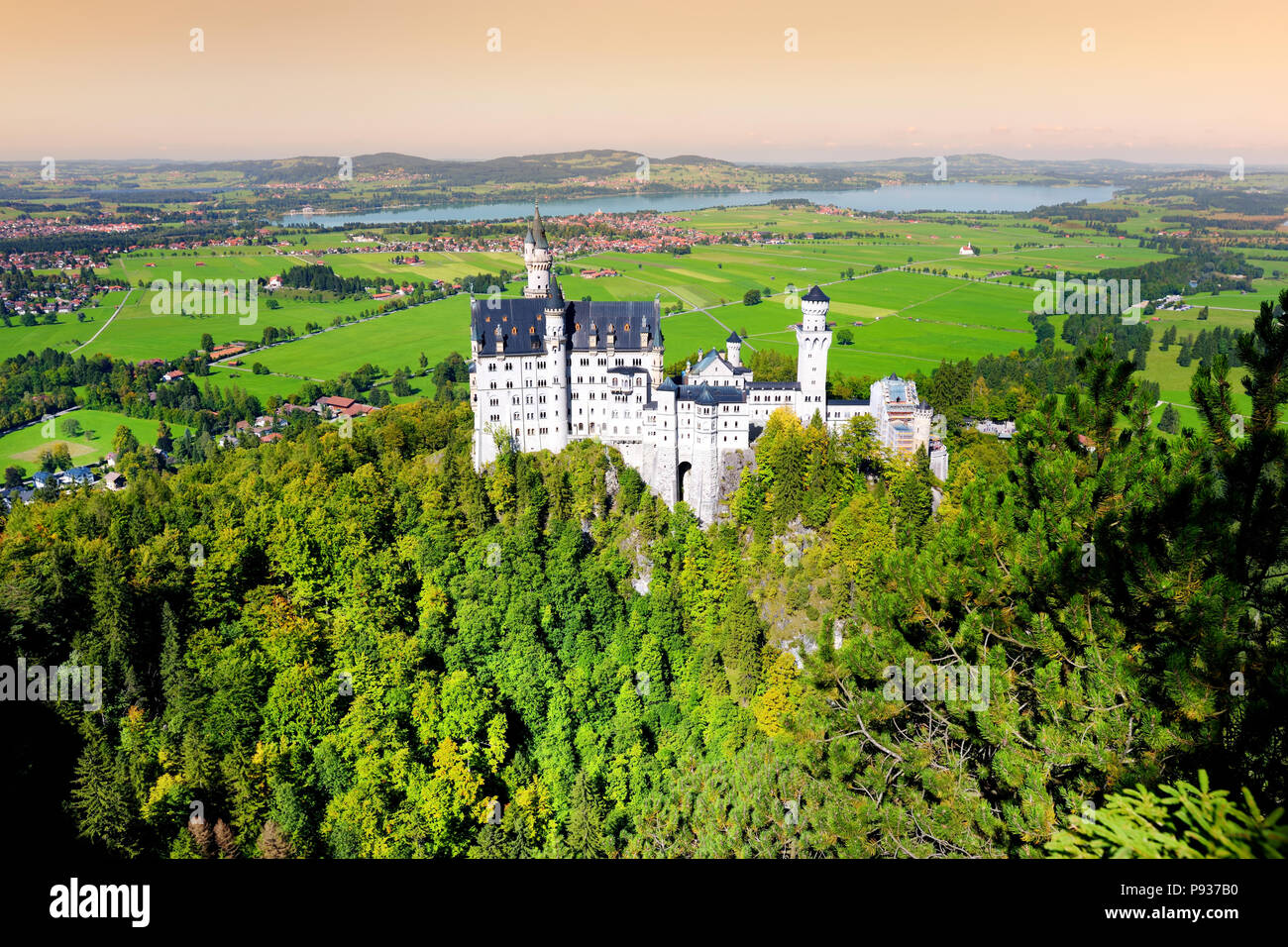 Famous Neuschwanstein Castle, 19th-century Romanesque Revival palace on a rugged hill above the village of Hohenschwangau near Fussen in southwest Bav - Stock Image