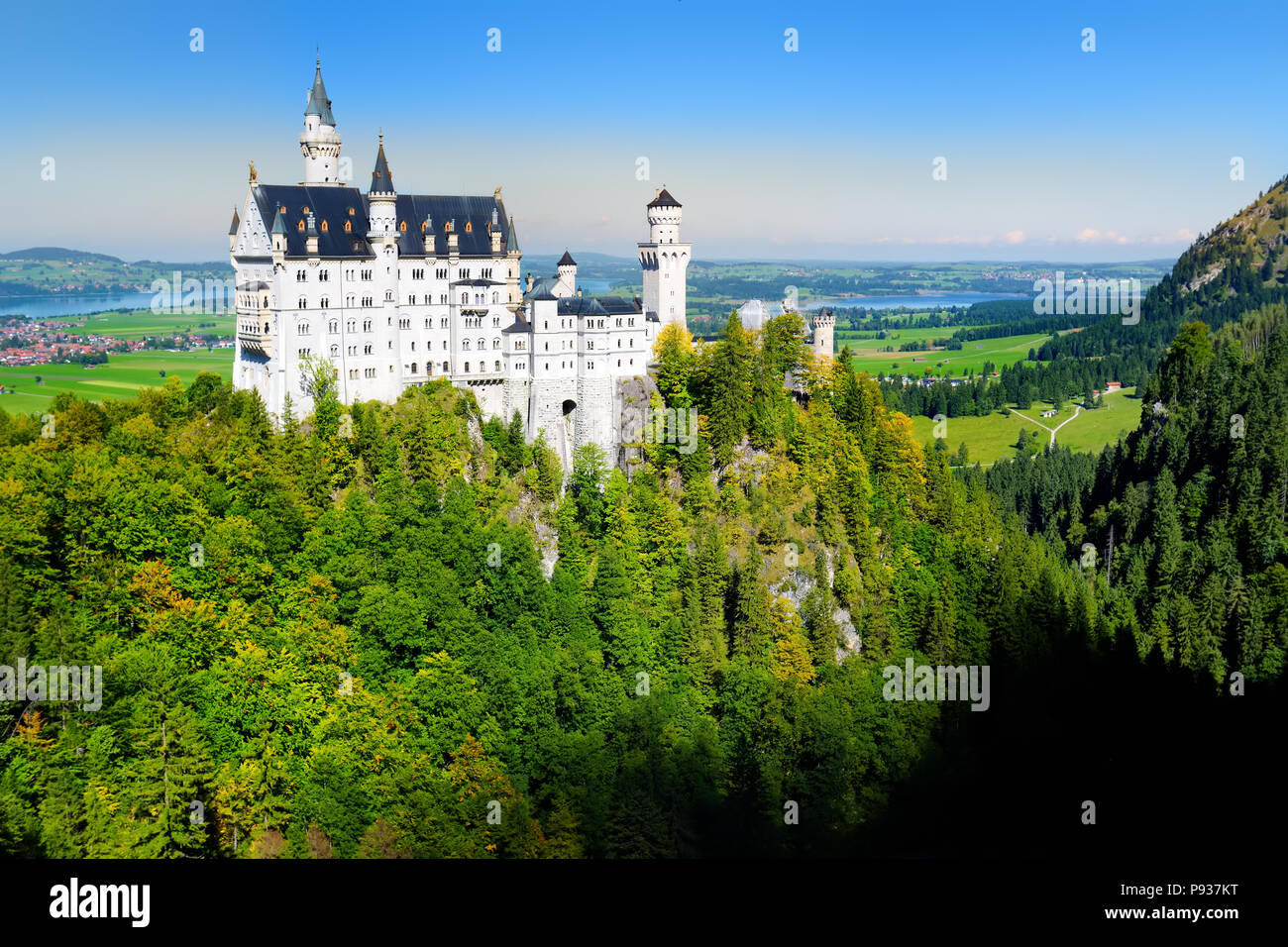 Famous Neuschwanstein Castle, 19th-century Romanesque Revival palace on a rugged hill above the village of Hohenschwangau near Fussen in southwest Bav Stock Photo