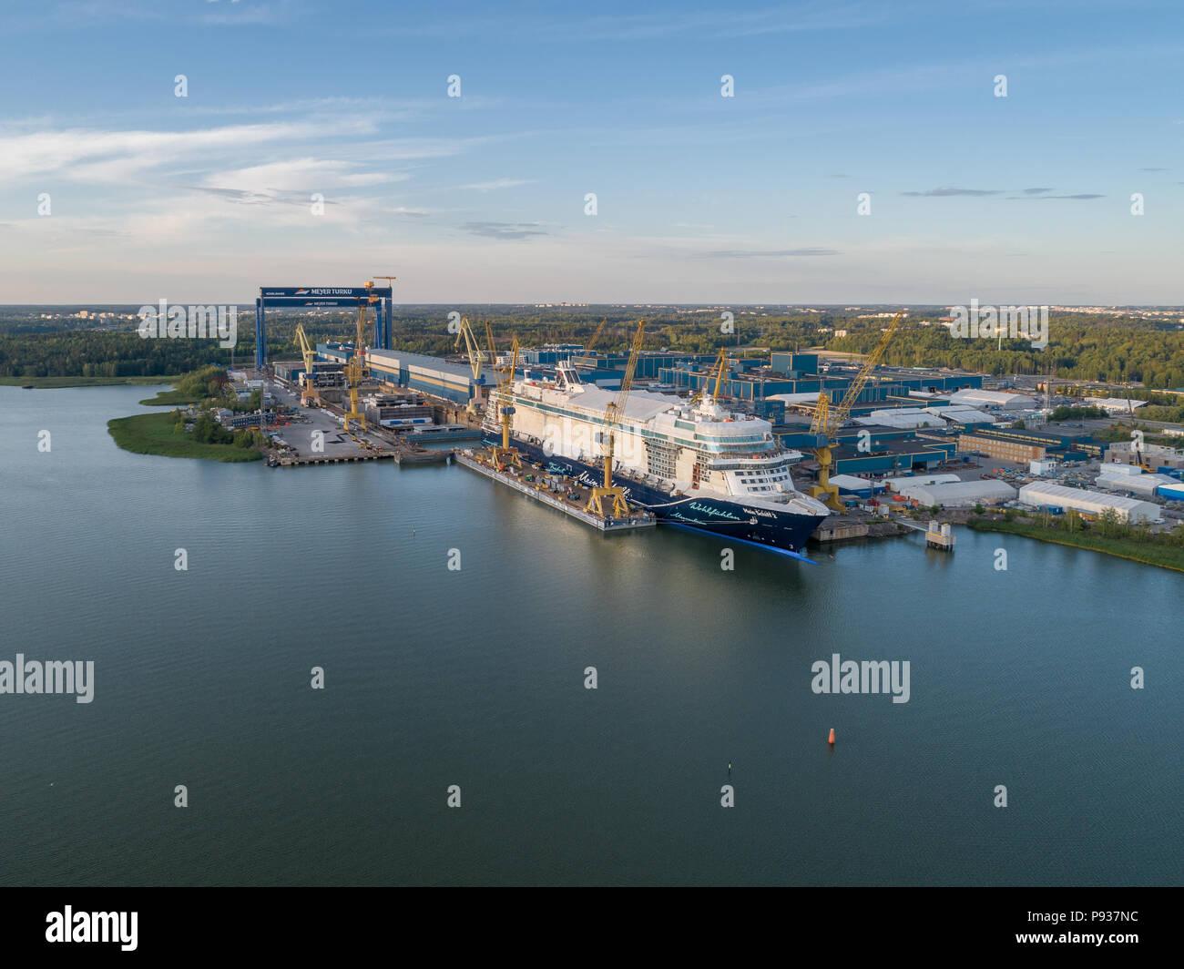 TURKU, FINLAND - 6/7/2018: Aerial view of Meyer Turku shipyard with Mein Schiff cruise ship under construction - Stock Image