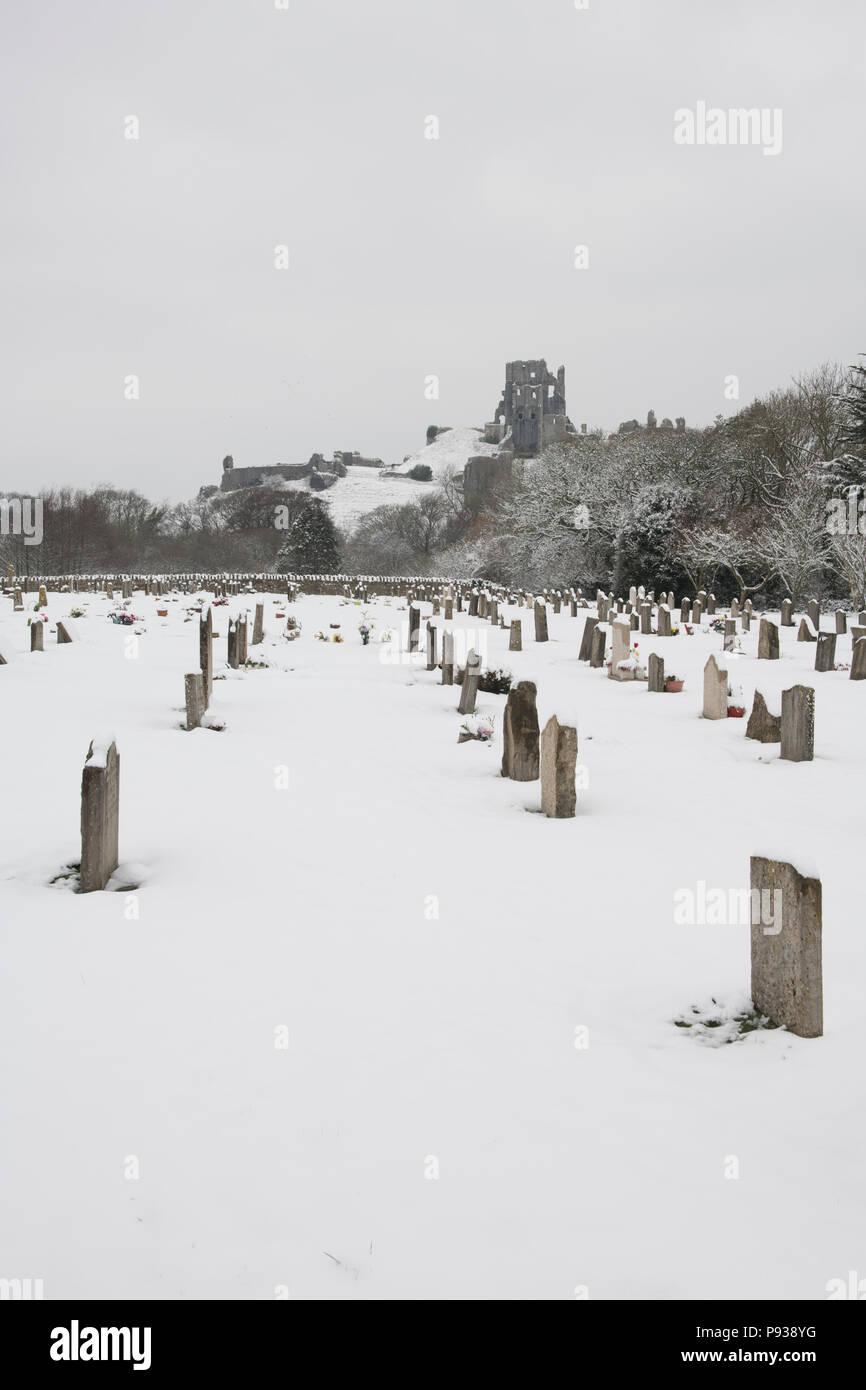 Corfe Castle Graveyard in the Snow. - Stock Image