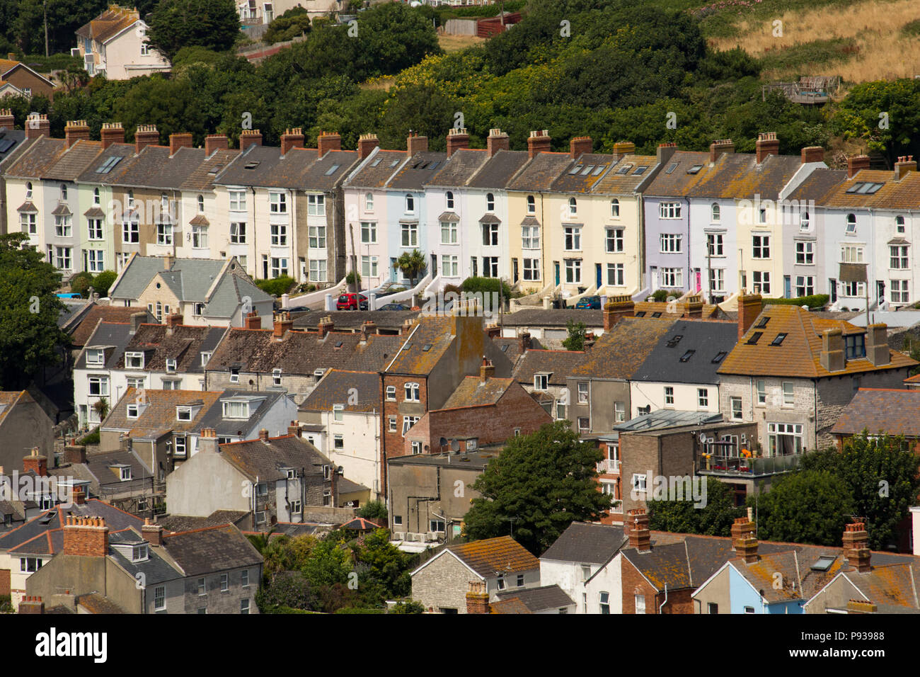 Houses in the village of Fortuneswell viewed from the cliffs on the Isle of Portland. Dorset England UK GB - Stock Image