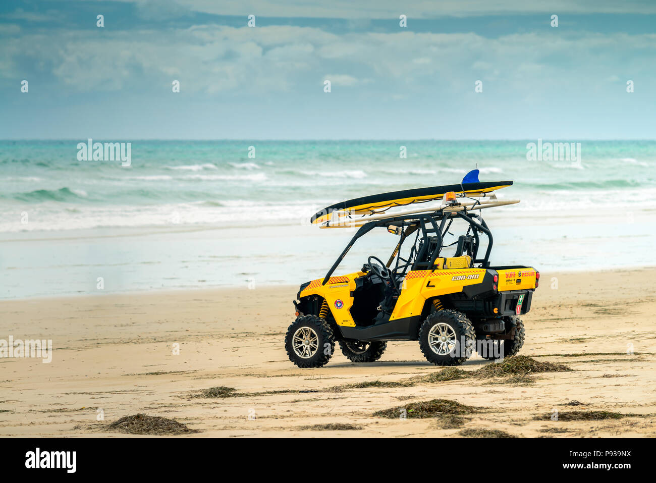 Adelaide, Australia - February 18, 2017: Australian surf life saving rescue car parked on the shore of  Sellicks Beach on a stormy day - Stock Image