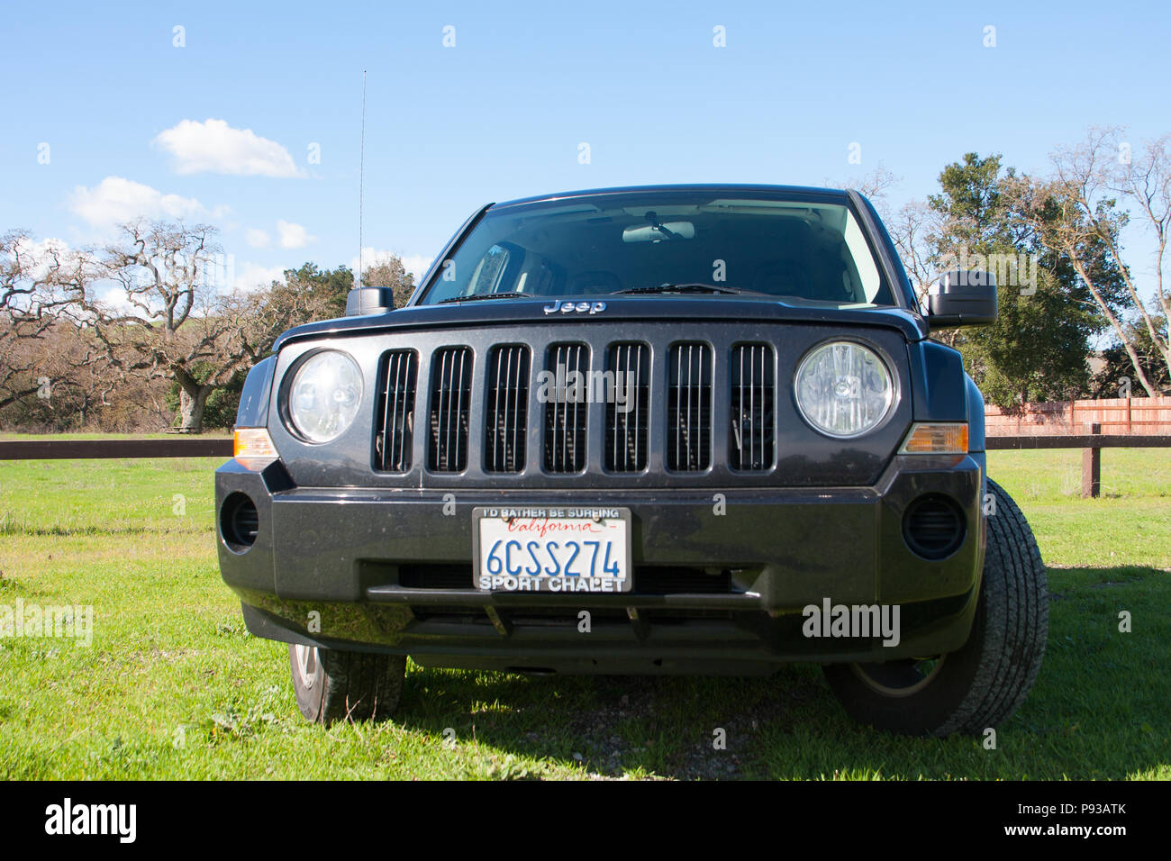 Black Jeep Patriot SUV (sport utility vehicle) in outdoor natural
