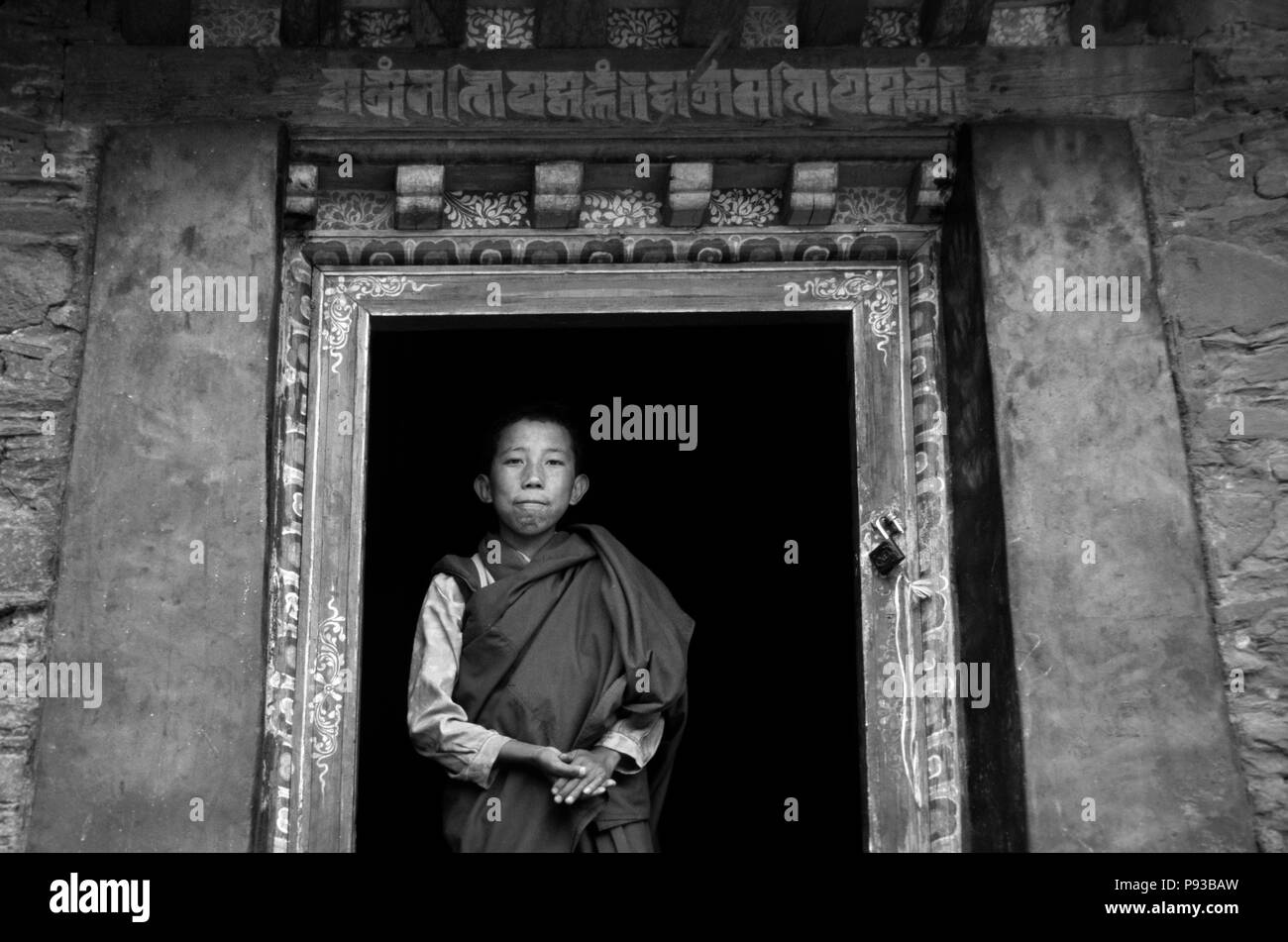 BUDDHIST MONK at TRANDRUK TEMPLE  which was founded by KING SONGTSEN GAMPO in the 7TH  Century - YARLUNG VALLEY, TIBET - Stock Image
