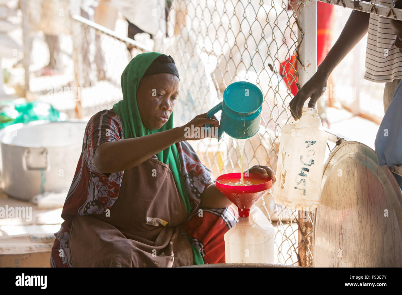 Kakuma, Kenya - Food distribution by the humanitarian aid organization World Food Program in a secure warehouse in the Kakuma refugee camp. - Stock Image