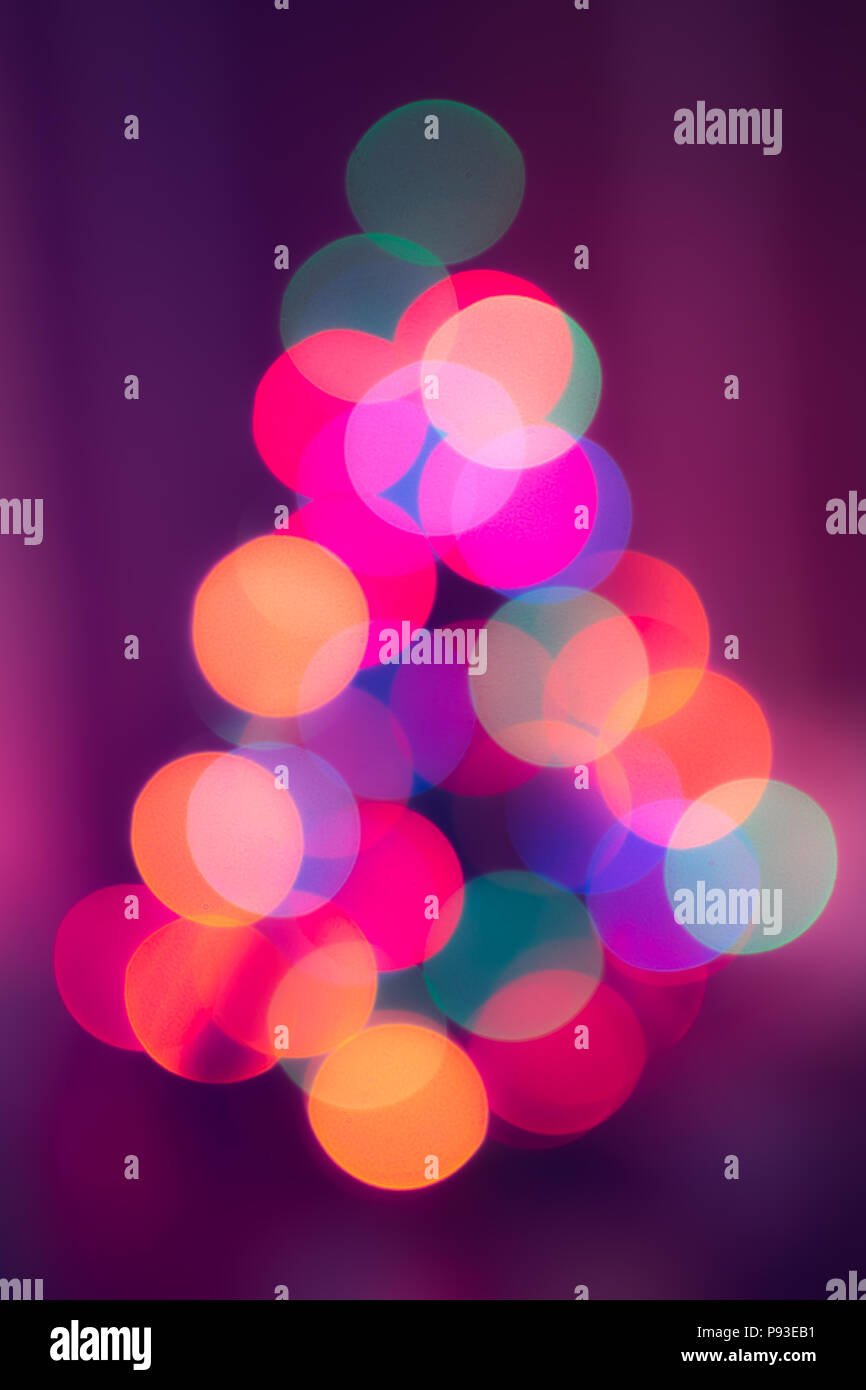 Christmas tree out of focus background bubbles - Stock Image
