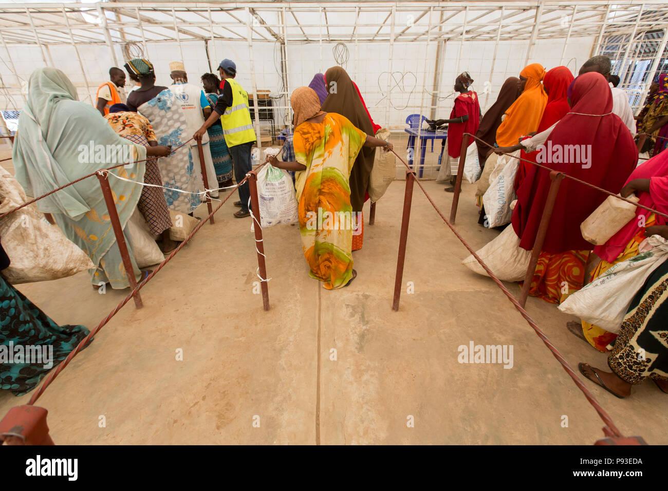 Kakuma, Kenya - Food distribution by the humanitarian aid organization World Food Program in a secure warehouse in the Kakuma refugee camp. Stock Photo