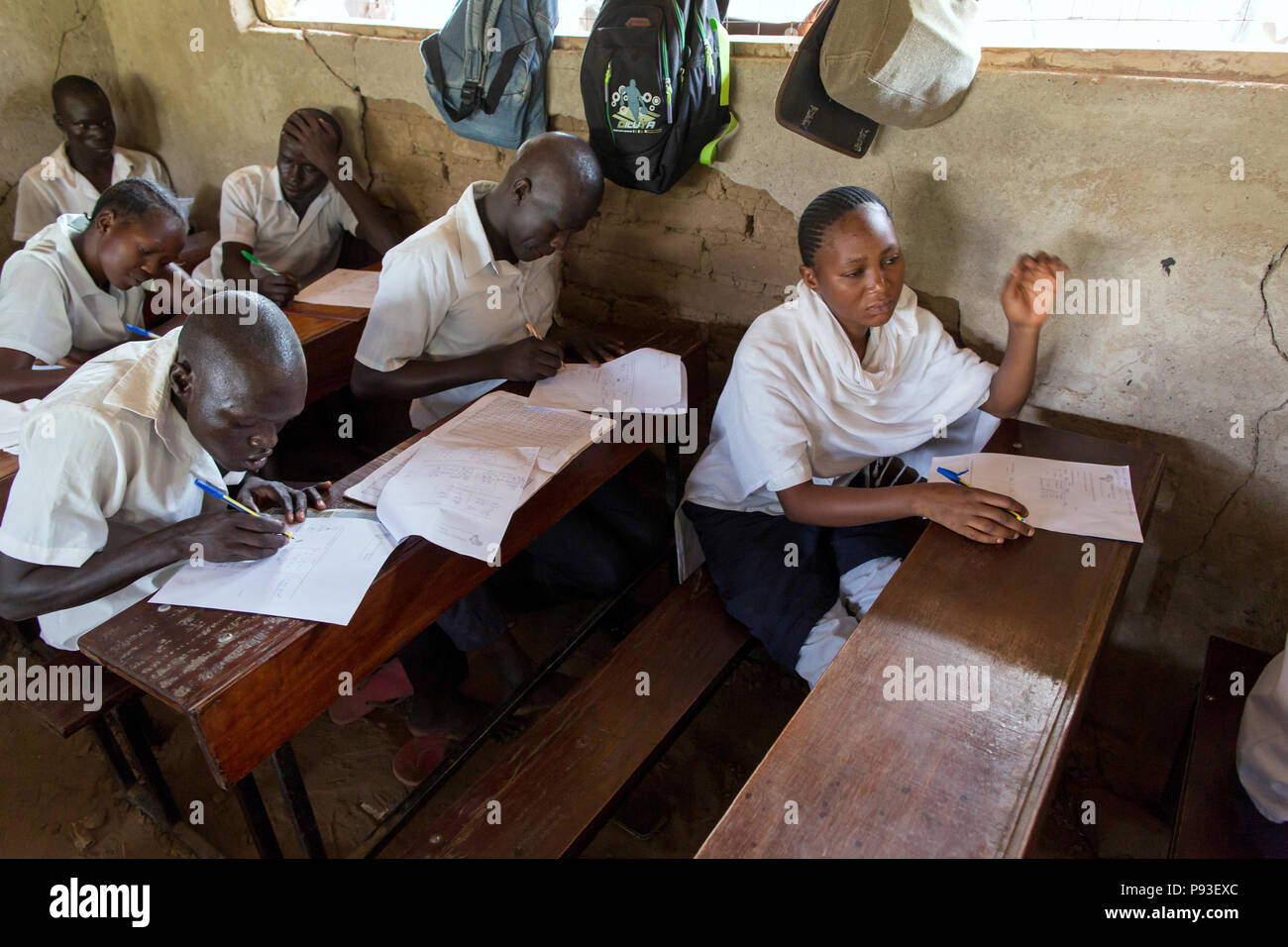 Kakuma, Kenya - Students write exams in a classroom of a school building in the Kakuma refugee camp. - Stock Image