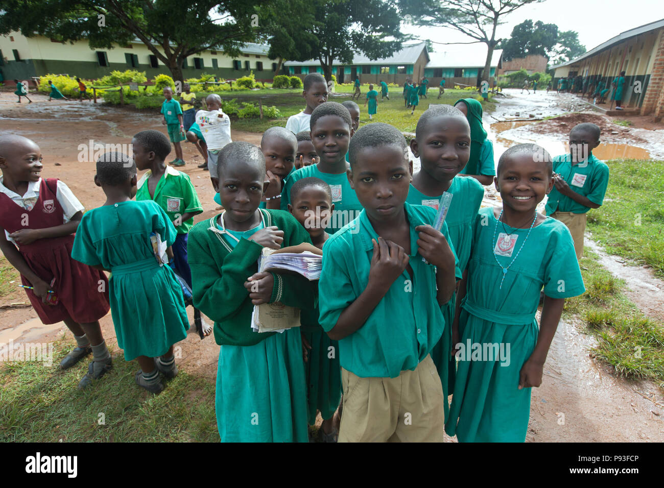 Bombo, Uganda - Primary school-uniformed students are standing in the schoolyard of St. Joseph's Bombo mixed primary school. - Stock Image