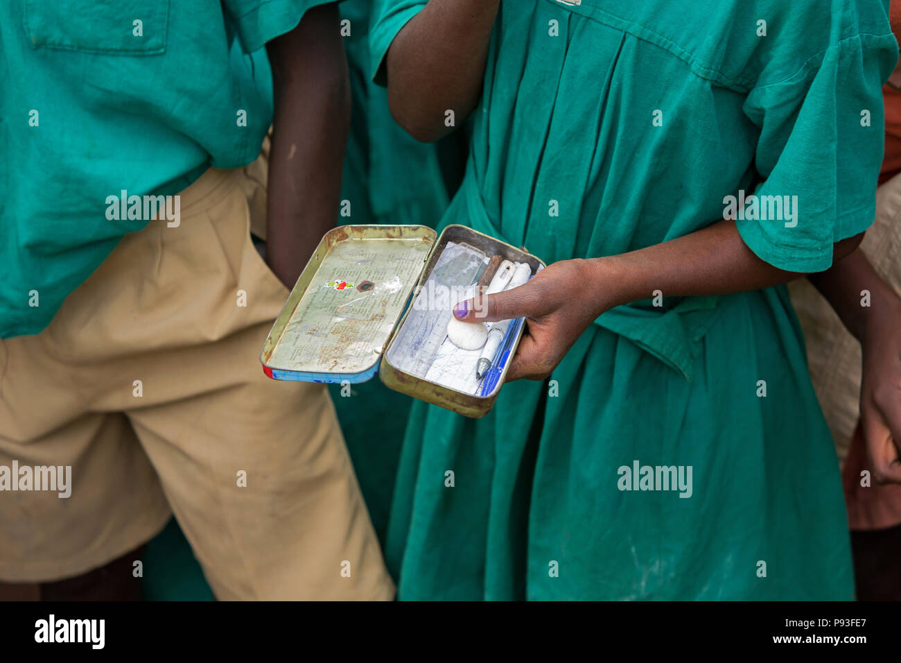 Bombo, Uganda - St. Joseph's Bombo mixed primary school. Ballpoint pen and ruler in an open pencil case made of sheet metal. - Stock Image