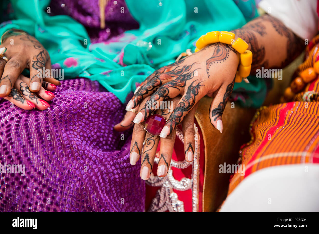Black and Brown Henna Hands Drawings on Women for African Wedding Ceremony Stock Photo