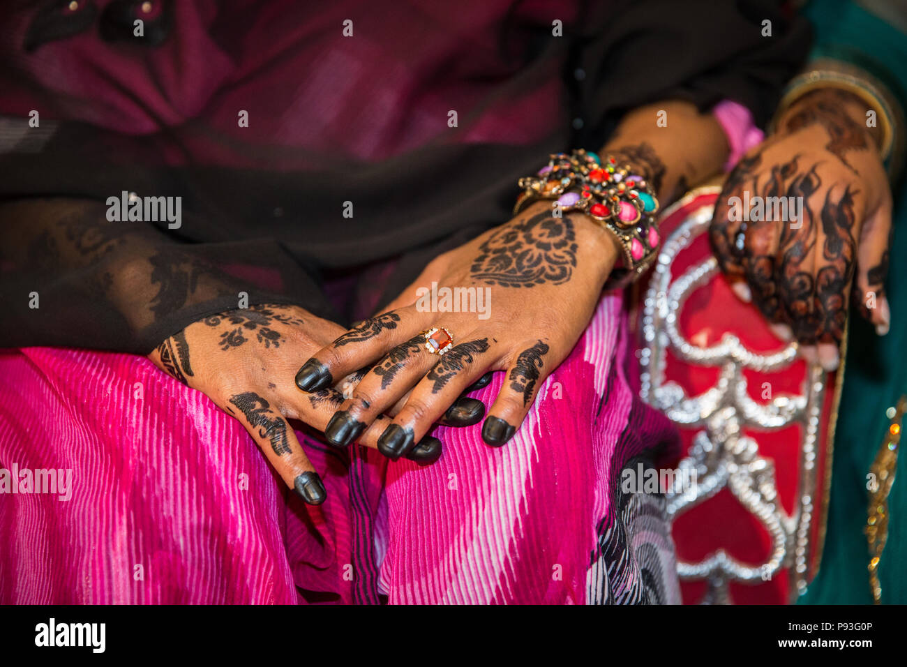 Black Henna Hands Drawings on Women for African Wedding Ceremony with Big Rings Stock Photo