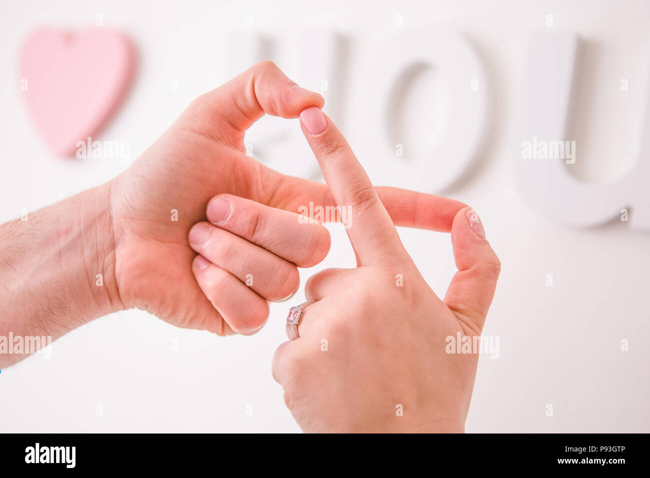 Newly Wed Couple Joining Hands In Infinity Love Sign With I Love You