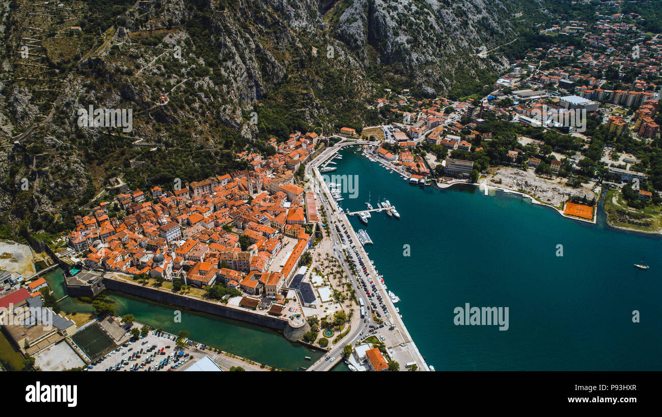 Aerial top view of old town Kotor and Boka Kotorska bay on the Adriatic sea in summer. Bay of Kotor is one of the most popular places on Adriatic Sea Stock Photo